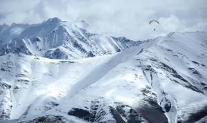 Patagonia ambassador Gavin McClurg flying during the Alaska paragliding traverse. Alaska Range, Alaska.